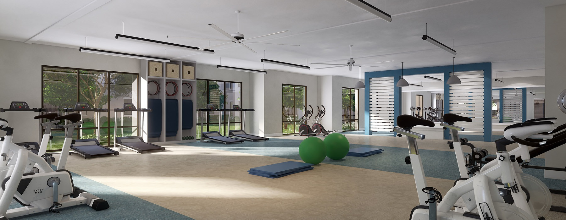 roomy fitness center rendering with large panel windows, ceiling fans and hanging fluorescent lights throughout